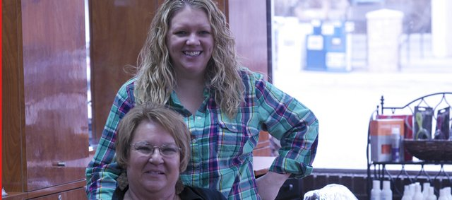 Emily Wright re-opened Whitney's Hair Salon last week after remodeling the business she recently purchased from her mother-in-law, Martha Wright (seated). Martha, who started working at the shop with her father Bill Whitney in 1979, is still working at the salon three days a week.