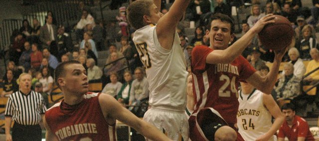 John Lean shoots against Basehor-Linwood's Chase Younger in the Chieftains' 47-33 loss to the Bobcats.