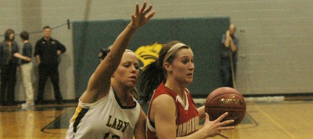Kara Stephens guards Tonganoxie's Hannah Kemp in the Bobcats' 52-46 loss to the Chieftains.
