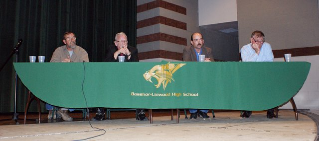 Mayoral candidates Alan Townsend, Fred Box, Scott Kendrick and incumbent David Breuer discussed growth, infrastructure development and communication with at a forum sponsored by the Basehor Chamber of Commerce on Monday night.