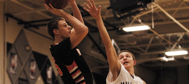 Anthony Kubas attempts a jumper late against Mill Valley on Tuesday, Feb. 12.