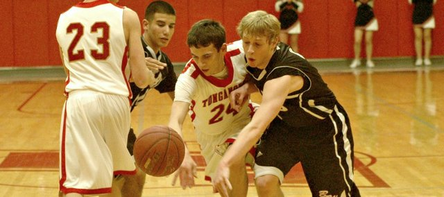 John Lean battles Bishop Ward's Evan Brull for a loose ball. The Chieftains held on for a 49-44 win against the Cyclones.