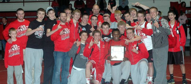 The Tonganoxie High wrestling team won its first regional title in school history Saturday in its own gym.