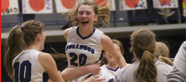 Senior Kelsey Dighans and the Bulldog bench greet an elated Maddie Ogle at the end of Baldwin's 35-33 overtime win Friday against Ottawa. The senior night victory ended a three-game Bulldog losing streak.