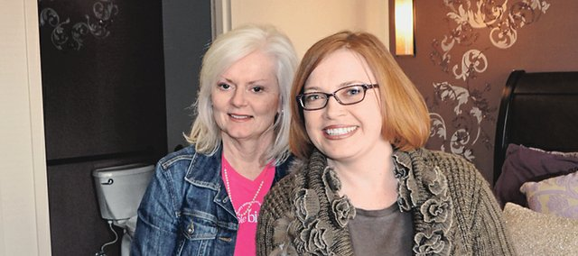 Cathy Gordon, left, and Kendra Wyatt, co-owners of New Birth Company, are pictured in one of the birthing rooms at the facility, Johnson Countys only midwife-led birth center.