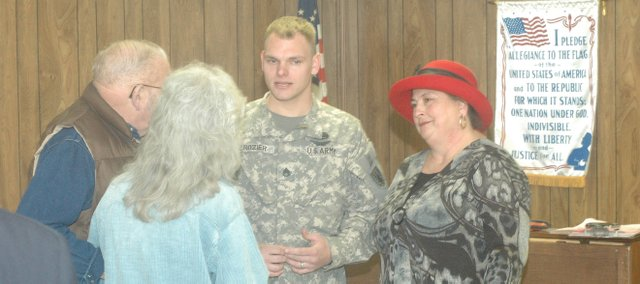 Staff Sgt. Zeke Crozier speaks with people who attended the Quilt of Valor ceremony. At right is his aunt; Meri O'Hare; who also is a member of the Tonganoxie Senior Quilters.