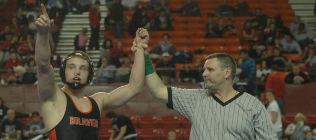 Jonathan Blackwell acknowledges the Bonner Springs fans after winning the 152-pound state title Saturday in Salina.