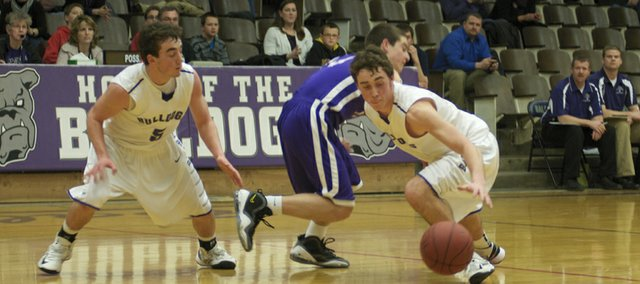 Baldwin's Chad Berg, left, and Luke Fursman team up on the press to force a turnover in the Bulldogs' fourth-quarter comeback against Louisburg. Baldwin scored the first 18 points in the quarter to tie the game at 37-37 before the Wildcats made the game-winning basket with 2.1 seconds remaining.