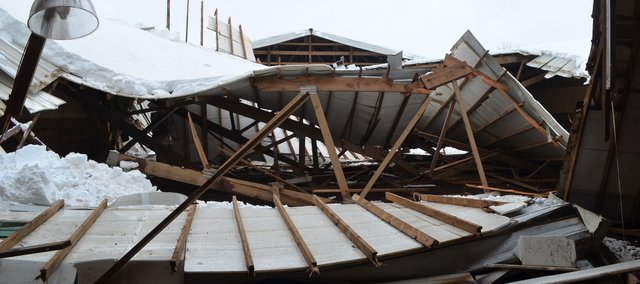 The roof at Covered M Arena, 17100 W. 53rd St., collapsed under the wet, heavy snow Tuesday morning, but no horses or humans were injured.