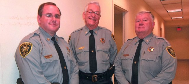 Former Leavenworth County Undersheriff Ron Cranor, middle, poses with current Sheriff Andy Dedeke, left, and former Sheriff Dave Zoellner; right. Cranor recently retired after many years of law enforcement.