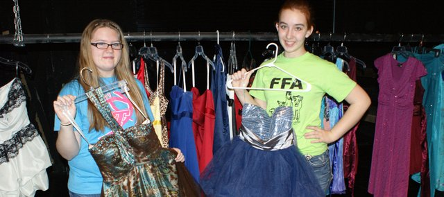 Danielle Focht, left, and Haley Arevalo, both Tonganoxie High School freshmen, have started Cinderella's Closet with the help of a grant and donations. The project offers free dresses to youths who are looking to attend spring formal events but might not be able to afford a new dress.
