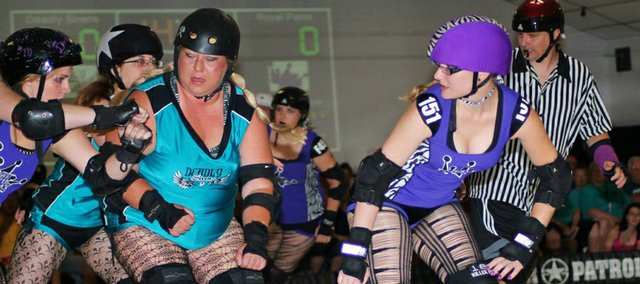 Matt Gurley, at rear, far right, keeps an eye on some derby players at the Dead Girl Derby September 2012 championship game.