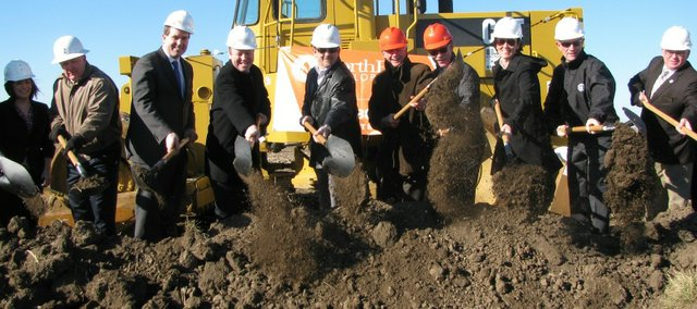 Joe Reardon, Mayor/CEO of the Unified Government of Wyandotte County and Kansas City, Kan. (third from left) and other Unified Government officials participate in the ceremonial groundbreaking for the Village West Luxury Apartments on Jan. 18.
