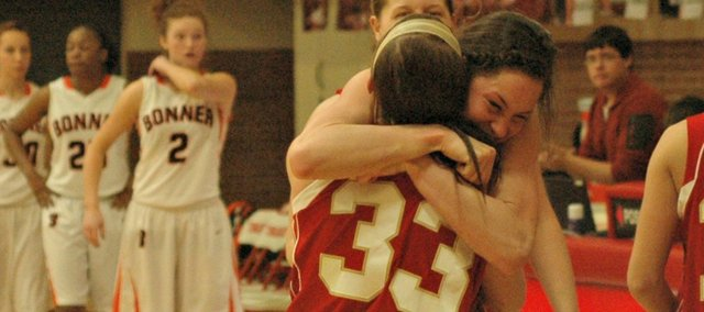 Tonganoxie High seniors Jenny Whitledge and Hannah Kemp embrace after the Chieftains knocked off top-seeded Bonner Springs in overtime.