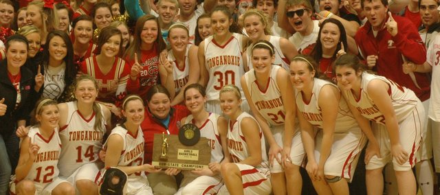 The Tonganoxie High girls basketball team and its fans pose with the Chieftains&#39; sub-state championship trophy after their 62-36 win against Atchison. THS is headed to state for the first time in six years.