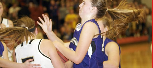 Baldwin's Maddie Ogle fights for the ball in the fourth quarter of the Bulldogs' loss in Saturday's finals of the sub-state finals against Paola. Ogle scored eight of her game-high 12 points in the fourth quarter.