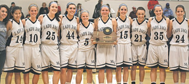 The Mill Valley girls basketball team poses with its 2013 sub-state trophy on Friday after defeating Shawnee Heights, 46-21, to advance to the program's first Class 5A state tournament. The Jaguars will begin tournament play on Wednesday.
