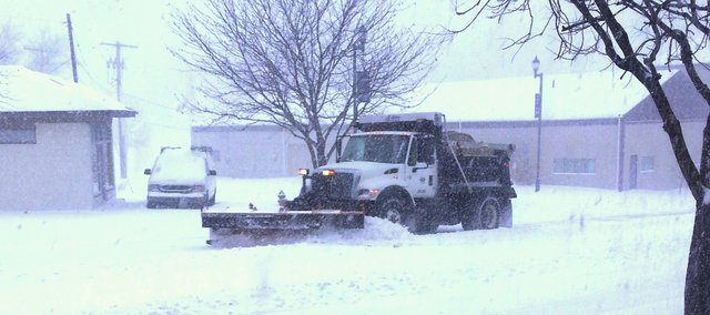 Tonganoxie Public Works trucks clear Fourth Street during one of the two recent snowstorms. Crews used 60 tons of salt and sand to combat the two snowstorms.