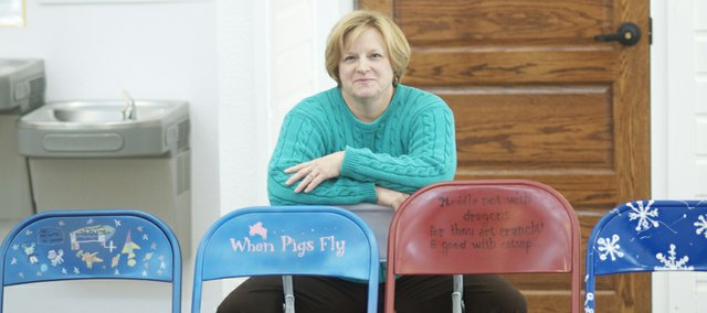 "Christine Rothschild sits behind her ""When Pigs Fly"" entry in a recent Lumberyard Arts Center contest, which had contestants competing in elementary students, junior high and high school students, adults and professional artist categories. Rothschild won the adult category."