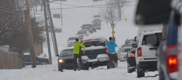 Motorists stuck in the snow between 71st and 75th streets on Quivira Road early Thursday afternoon created one of many traffic jams police responded to during the day. More severe weather could be on the way say state and weather officials.