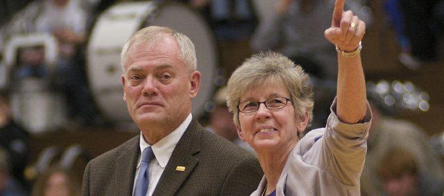 Ginny Honomichl acknowledges the crowd at a recent home basketball game after receiving an award from Kansas State High School Activities Association Executive Director Gary Musselman for being named the National Coach Contributor from the National Federation of State High School Associations.