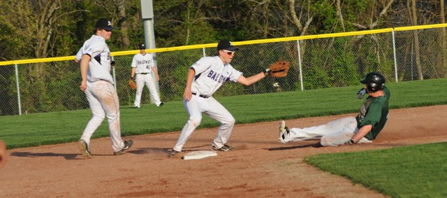 Baldwin junior Brock Randels fields a throw to second base during a game last season, Randels will again be patrolling the infield for the Bulldogs with man other underclassmen who gained experience last year.