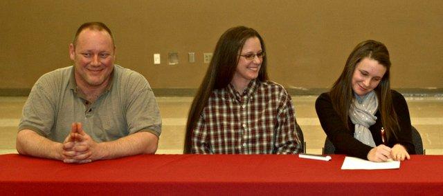 Tonganoxie High senior Savannah Bailey, far right, will play softball next season at Kansas City Kansas Community College.