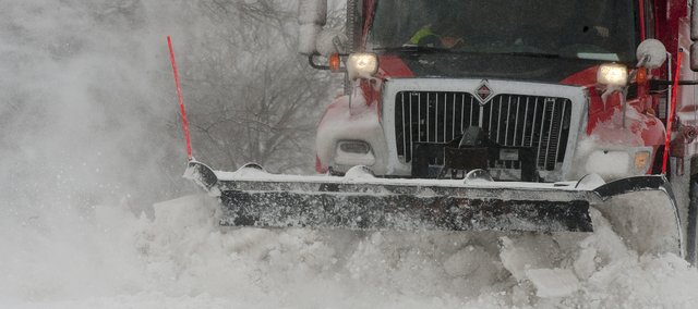 A Kansas Department of Transportation snowplow heads east on U.S. HWY 24 Sunday March 24, 2013.