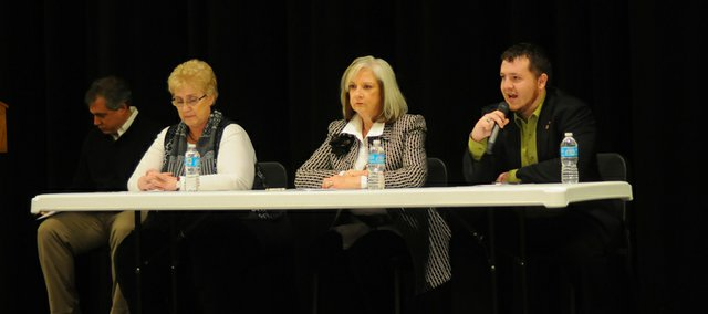 Jason Mock, right, answers a question at Tuesday candidate forum at the Performing Arts Center as Marilyn Pearse, left at table, and Bonnie Plumberg wait their turns. The three candidates for mayor of Baldwin City answered questions and made opening and closing statement on their candidacies at the hour-long forum.