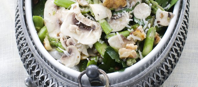 A raw asparagus, mushroom and parsley salad with nuts is a wonderfully flavorful and crisp dish for spring.