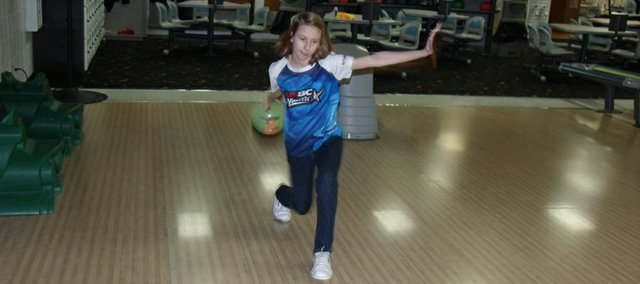Kyah Surritte prepares to throw her bowling ball as she conducts her science experiment.