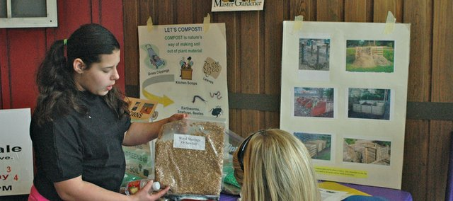 Tessa Gallardo, a 4-H Club member from Turner, discusses appropriate materials for composting Saturday at the Bonner Springs City Library.