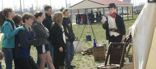 Ryan Todd explains artifacts in the campsite he and his father Mike Todd take to Civil War re-enactments to fellow Baldwin Junior High School students during an enactment Friday at the Baldwin Elementary School Intermediate Center. The seventh-grader organized the event that drew re-enactors to the school.