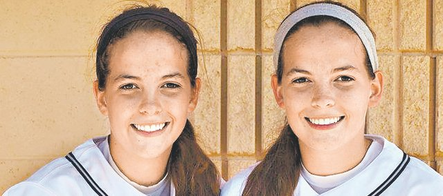 Mill Valley sophomores Lacie (left) and Lexie Myers have been a catcher and pitcher combo for just eight years fewer than they have been twin sisters. Entering Wednesday's game against Bishop Ward, Lexie Myers is 2-0 while pitching for the Jaguars this season.