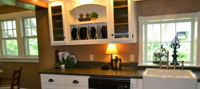 A clean and organized space, such as this kitchen, helps to promote peace of mind, says professional organizer Mary Ellen Vincent. Below, she offers some tips on how to get started and how to stay organized, too.