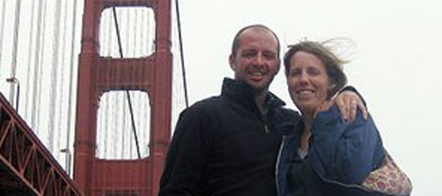 Kit and Sarah Harris and their son Cael were unharmed from Monday's bombings during the Boston Marathon. Sarah was running in the event, and the couple is shown here when she ran in the 2010 San Francisco Marathon.