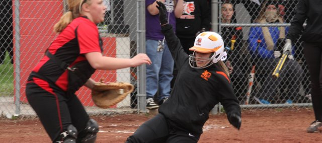 BSHS freshman Morgan Reed slides home for the tying run in an 8-7 win against Lansing on Tuesday. The Braves and Lions split the doubleheader, dropping BSHS to 1-7.