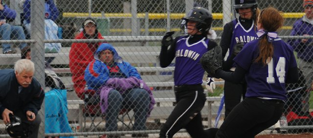 Sierra Hall crosses the plate Tuesday for the Bulldogs in Baldwin's five-run fifth inning in a game against Louisburg. Baldwin scored 22 runs in the sweep of the visiting Wildcats.