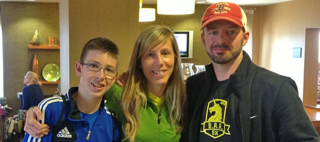 Sarah and Kit Harris and their 13-year-old son Cael pose in the lobby of the Boston hotel they stayed in during a trip last week for the Boston Marathon. Sarah ran in race but unable to finish because of the bombings.