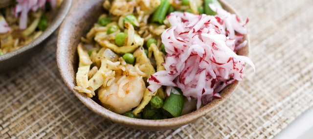 Shrimp Fried Rice with Pickled Radishes features three spring vegetables: peas, sugar snap peas and fresh radishes. You can also switch the shrimp for a different protein of your choice, or use fresh mushrooms for a vegetarian version.