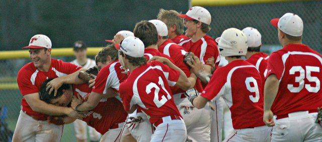 Brett Shelton is mobbed by teammates after Tonganoxie's 4-3 win Monday against Bishop Ward.