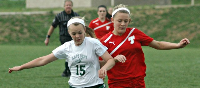 Tonganoxie's Emily Soetaert tries to beat Basehor-Linwood's Raeney Seaton to a loose ball in Wednesday's meeting. Soetaert scored twice in the Chieftains' 6-2 victory.