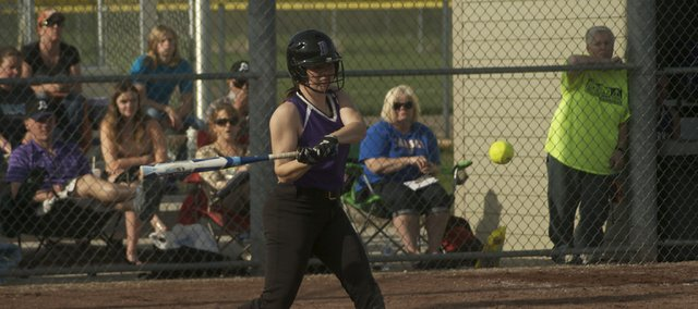 Emily Simpson gets a hit for Baldwin in the first game of the Bulldogs' double header Tuesday against Burlingame. Baldwin won the first game but lost the nightcap.