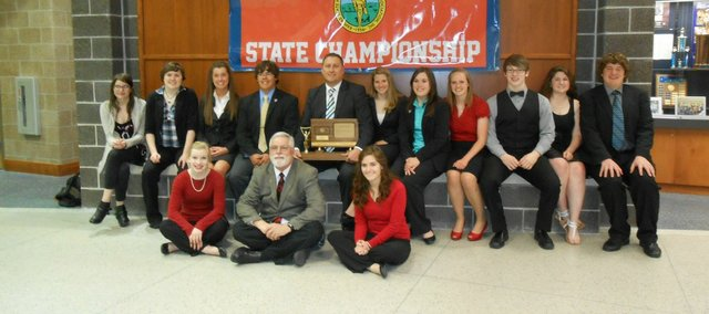 The Tonganoxie High School state forensics team gathers with its state runner-up trophy May 4 at KCKCC. The team placed second in Class 4A at state for the third consecutive year. The team finished third in 2010 and 2009 and won a state title in 2008.