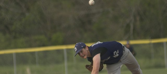 Baldwin lefty Brandon Mock brings home a pitch late in Thursday regional semi-final game against De Soto. The junior pitched two scoreless innings in relief in the Bulldogs' 8-6 season-ending loss.