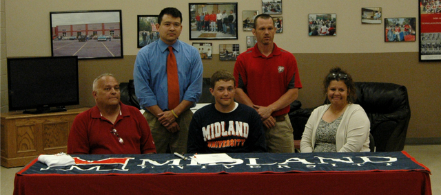 Tonganoxie High senior Gus Dent, center, will continue his wrestling career next season at Midland University in Fremont, Neb.