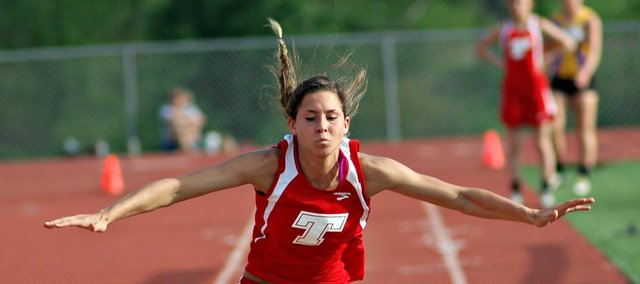 Jenny Whitledge was one of four Tonganoxie High athletes to qualify for the state track and field meet in regional action Friday in Baldwin City. Whitledge won the high jump and long jump at the meet.