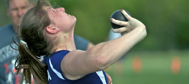 Baldwin senior Katie Kehl releases a throw Friday during the shot put competition at the 4A regional track and field meet at Liston Stadium. The Bulldog girls team easily won the regional title with Kehl winning the shot put and discus.