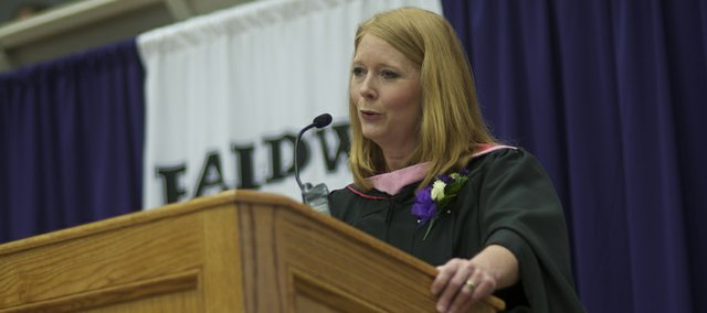 "Former Baldwin music teacher Jocelyn Leonard addresses the Baldwin High School Class of 2013 during Saturday's commencement. She praised the class for helping raise money for a annual student heart clinic after learning of the death of her son Wes from sudden cardiac arrest and concluded her speech with the Irish tune ""May the Road Rise to Meet You."""
