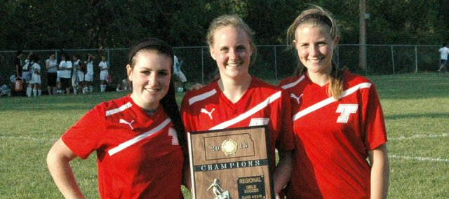 Tonganoxie High seniors Molly Welsh, left, Kelsi Briggs, center, and Christopher Tiner have helped transform the Chieftain girls soccer team into a two-time regional champion.